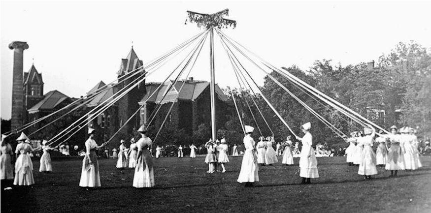 May Queen and her court around may pole on May Day
